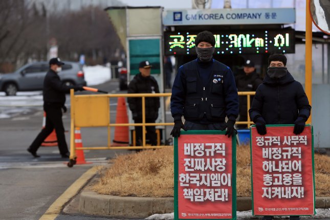 Unionized workers of GM Korea Co., the South Korean unit of General Motors, portest against the plants closure at the gate to its plant in the western port city of Gunsan, South Korea, 14 February 2018. General Motors Co. announced it will shut down an assembly plant in South Korea, one of its four in the country, by the end of May due to a fall in demand. File Courtesy of Yonhap/UPI.