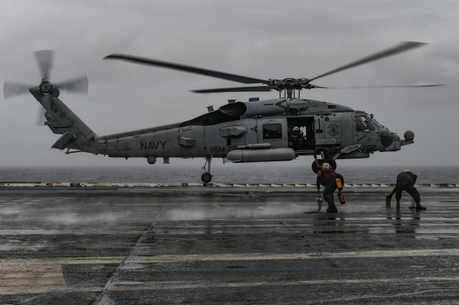 An MH-60R Seahawk helicopter, assigned to the Proud Warriors of Helicopter Maritime Strike Squadron 72, prepares to land aboard the Nimitz-class aircraft carrier USS Harry S. Truman. Photo by Mass Communication Specialist 3rd Joseph A.D. Phillips/U.S. Navy
