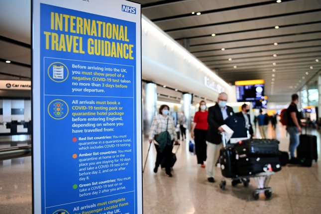 Travelers arrive at Heathrow Airport in London on June 8. File Photo by Andy Rain/EPA-EFE