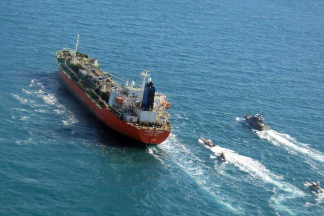 A photo made available by the Tasnim News Agency shows Iranian Revolutionary Guard Corps boats seizing a South-Korean flagged tanker in the Persian Gulf on January 4. Photo courtesy of Tasnim News Agency/EPA-EFE