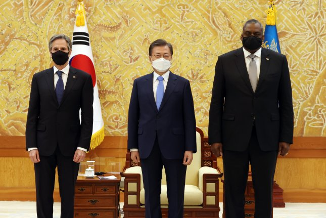 South Korean President Moon Jae-in (C) meets with U.S. Secretary of State Antony Blinken (L) and Defense Secretary Lloyd Austin (R) during their courtesy call at the presidential Blue House in Seoul, South Korea, on Thursday. Photo by Yonhap/EPA-EFE