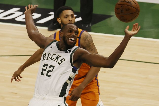 Milwaukee Bucks forward Khris Middleton (22) gets fouled while driving past Phoenix Suns guard Cameron Payne during the third quarter in Game 4 of the NBA Finals on Wednesday at Fiserv Forum in Milwaukee. Photo by Tannen Maury/EPA-EFE