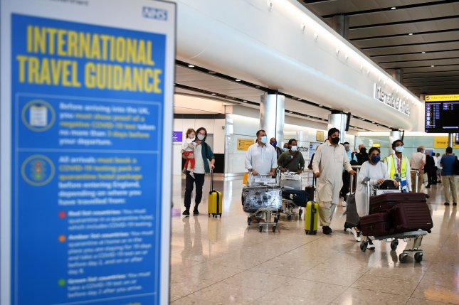 Travelers arrive at the Heathrow Airport in London on June 8. The United States has added Britain to its list of Level 4 travel advisories for COVID-19. File photo by Andy Rain/EPA-EFE