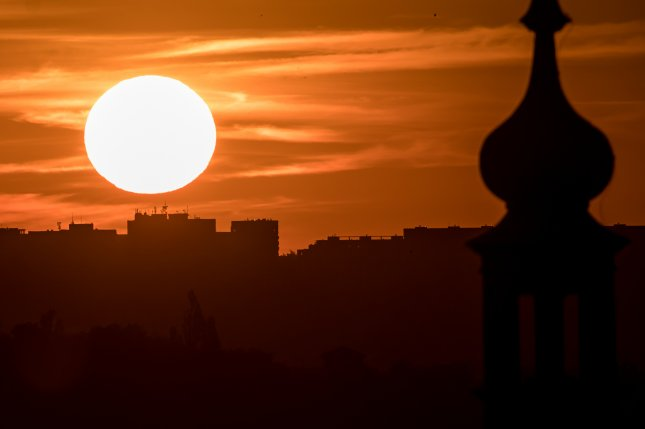 Real-time analysis of the images provided by the spacecraft cameras could help forecasters pinpoint solar storm threats days in advance, they said. Pictured, the sun rises over Prague, Czech Republic, in June 2019. Photo by Martin Divisek/EPA-EFE