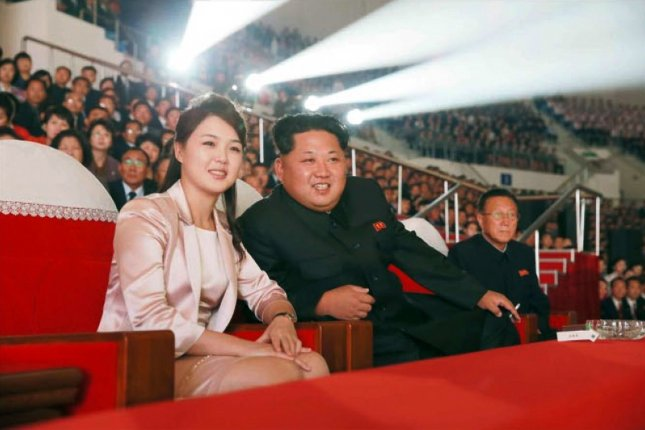 North Korean first lady Ri Sol Ju (L), shown here with Kim Jong Un in 2015, made her first public appearance in four months at Mount Kumgang, in a photo published Wednesday. File Photo by Rodong Sinmun/EPA