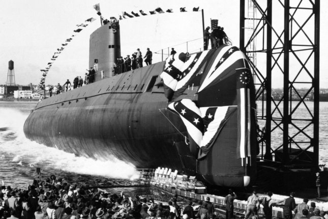 The nuclear-powered submarine USS Nautilus (SSN 571) slips into the Thames River in New London, Conn., on January 21, 1954. The Navy commissioned the submarine September 30, 1954. File Photo by U.S. Navy/UPI