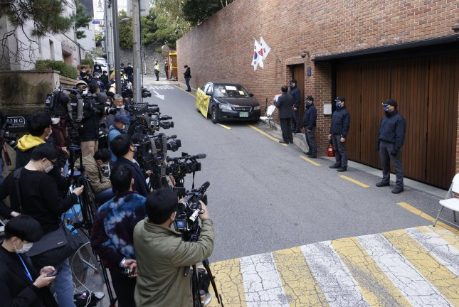 Journalists wait for former South Korean President Lee Myung-bak in front of the former president's residence in Seoul on Thursday. South Korea's Supreme Court upheld a lower court ruling of a 17-year prison term for Lee, who was charged with embezzlement and bribery. Photo by Kim Chul-soo/EPA-EFE