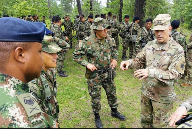 Maj. Gen. Daniel R. Walrath, right, U.S. Army South commanding general, greets Colombian soldiers during a visit to the Joint Readiness Training Center at Fort Polk, La., June 9. Photo by Donald Spark/U.S. Army South