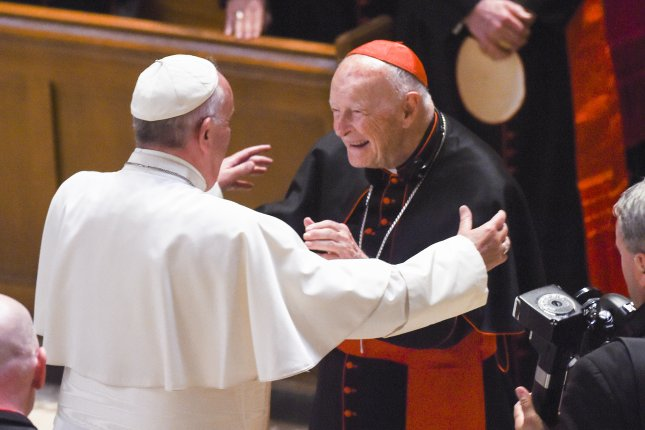 Pope Francis embraces Cardinal Archbishop emeritus Theodore McCarrick  in Washington, D.C., in 2015. File Pool Photo by Jonathan Newton/EPA
