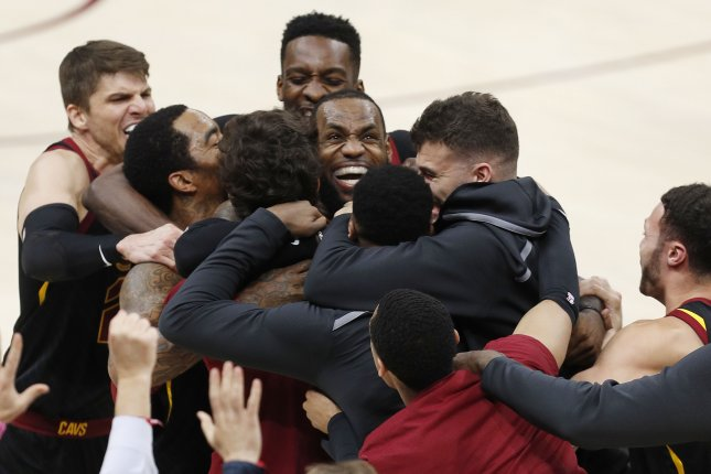ca566000f6b6 LeBron James (C) of the Cleveland Cavaliers celebrates with teammates after  making the game winning shot to defeat the Indiana Pacers during the second  half ...