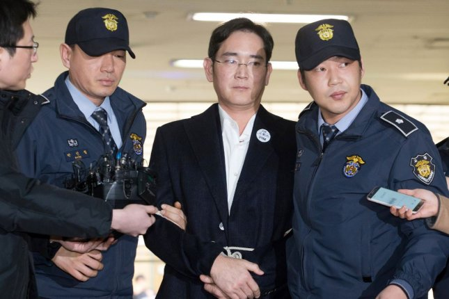 Samsung Electronics Vice Chairman Lee Jae-Yong (C), shown during a 2017 arrest on bribery charges, and his sister Lee Boo-jin, chief executive of Shilla Hotels, are under investigation for illicit drug use. File Photo by Jung Ui-chel/EPA