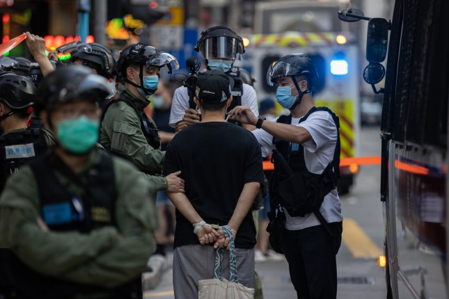 Nearly 300 people were arrested during protests in Hong Kong on what was originally scheduled to be the region's election day Sunday. EPA-EFE/JEROME FAVRE