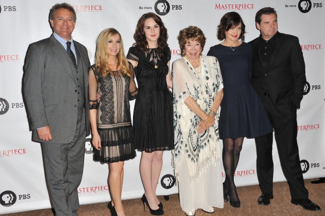 Downton Abbey stars, left to right, Hugh Bonneville, Joanne Froggatt, Michelle Dockery, Shirley MacLaine, Elizabeth McGovern and Brendan Coyle at photocall at the Beverly Hilton Hotel in Los Angeles on July 22, 2012. Photo by Jaguar PS/Shutterstock.com