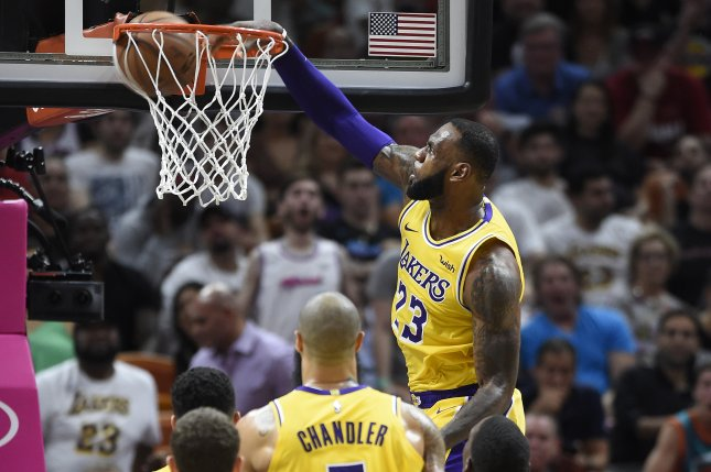 Los Angeles Lakers forward LeBron James dunks against the Miami Heat during the first half of their NBA game on Sunday at AmericanAirlines Arena in Miami. Photo by Rhona Wise/EPA-EFE