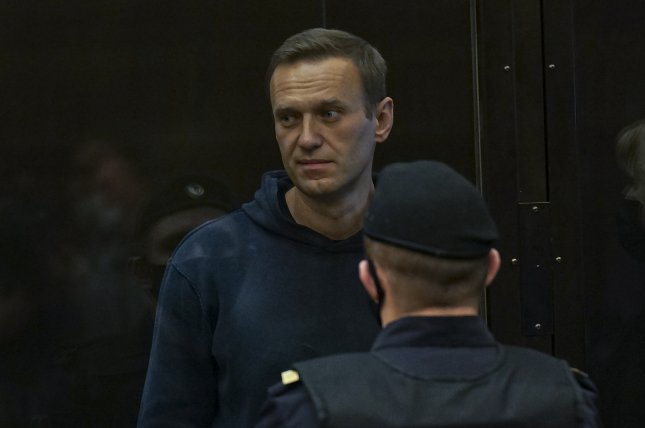 Russian opposition leader Alexei Navalny stands in a glass cage during a hearing in the Moscow City Court in Moscow on Tuesday. Photo courtesy of the Moscow City Court Press Service
