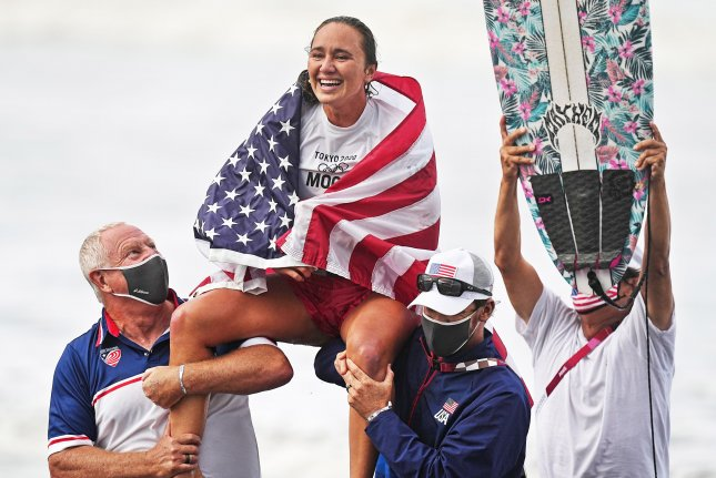 Carissa Moore of the United States celebrates winning gold in the women's final of the surfing competition of the 2020 Olympic Games at the Tsurigasaki Surfing Beach in Ichinomiyai, Japan, on Tuesday. Photo by Nic Bothma/EPA-EFE