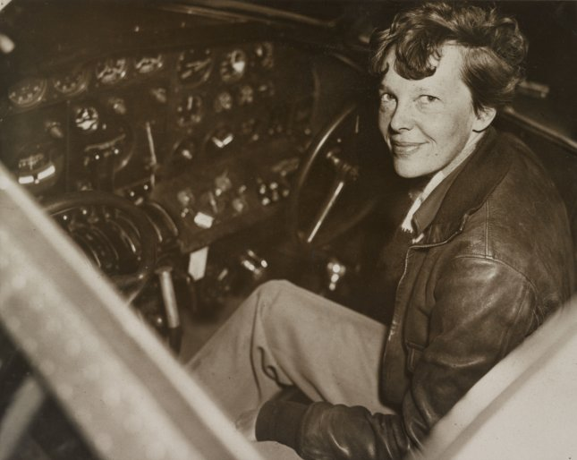 Aviator Amelia Earhart pictured sitting in the cockpit of her Electra airplane. File Photo UPI