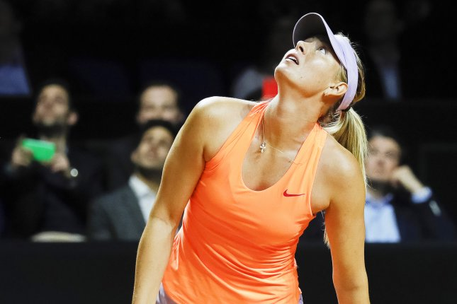 Maria Sharapova of Russia reacts during her second round match against her compatriot Ekaterina Makarova at the Porsche Tennis Grand Prix tournament on Thursday in Stuttgart, Germany. Photo by Ronald Wittek/EPA