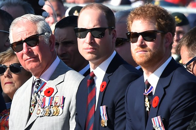 Prince Charles, Prince William and Prince Harry (L-R) attend a ceremony at the Canadian National Vimy Memorial in Vimy, France, on April 9. Prince William and Prince Harry will attend a service to rededicate Princess Diana's grave July 1. File Photo by Philippe Huguen/EPA