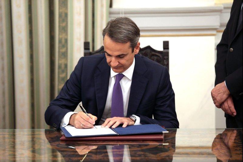 Greek Prime Minister Kyriakos Mitsotakis signs documents following his swearing-in ceremony Monday in Athens, Greece. Photo by Pantelis Saitas/EPA-EFE