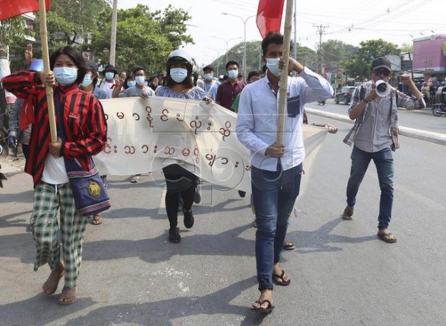 Demonstrators march Saturday during an anti-military coup protest in Mandalay, Myanmar. Photo by Stringer/EPA-EFE