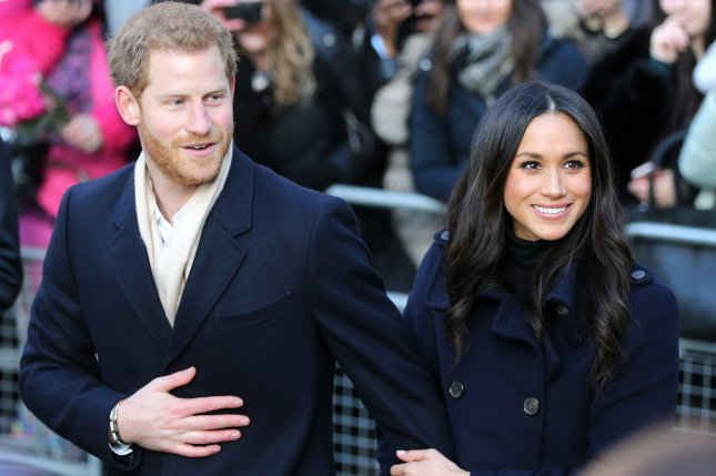 Prince Harry (L) and Meghan Markle greet crowds before attending an event at Nottingham Contemporary for World AIDS Day on December 1. Markle has confirmed that her father Thomas Markle will be unable to attend the royal wedding as he needs to focus on his health. File Photo by Nigel Roddis/EPA-EFE