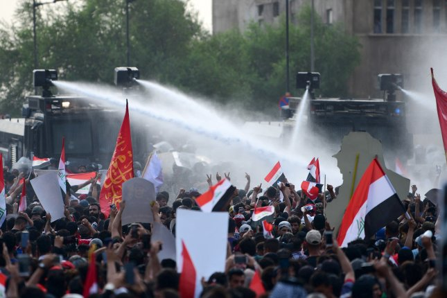 Iraqi anti-riot policemen use water cannons to block Iraqi protestors during a demonstration at al-Tahrir square in Baghdad last month. Iraq rejected U.S. calls for early elections Monday. File Murtaja Lateef/EPA-EFE