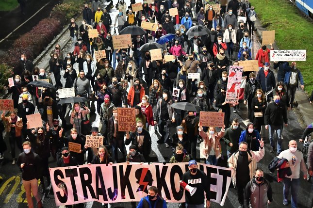 People take part in a protest against the tightening of the abortion law in Wroclaw, western Poland, on Tuesday. Photo by Maciej Kulczyski/EPA-EFE