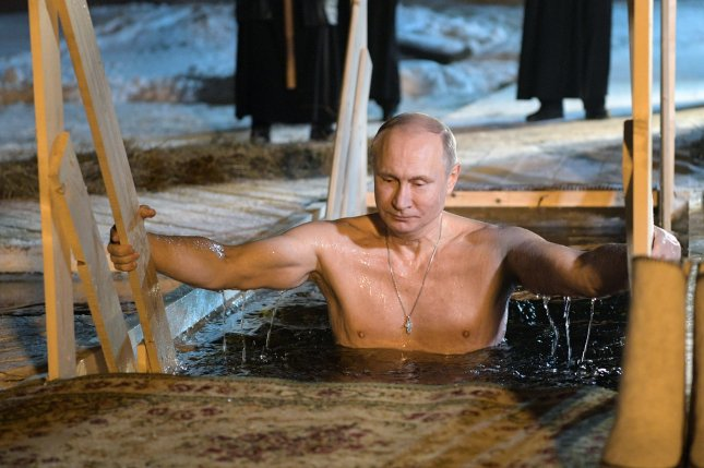 Vladimir Putin takes dip in freezing water to observe Epiphany