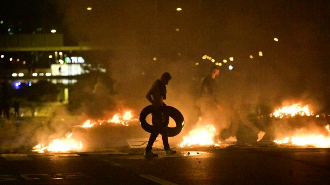 Demonstrators burn tires as protesters riot Friday night in the Rosengard neighborhood of Malmo, Sweden. Photo courtesy of TT News Agency/EPA-EFE