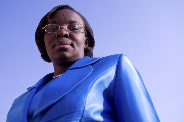 Rwandan opposition leader Victoire Ingabire poses for a photographer in Kigali, Rwanda, in 2010, the year she was arrested. Ingabire was sentenced to 15 years in prison in 2013 after a conviction for conspiring against the government but this week she was pardoned. Photo by Olivier Boulet/EPA