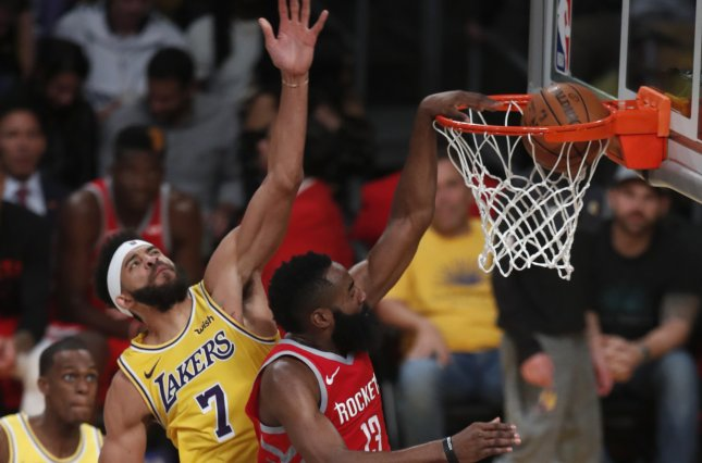 Houston Rockets guard James Harden (R) had a 50-point triple-double against the Los Angeles Lakers on Thursday in Houston. Photo by Mike Nelson/EPA-EFE