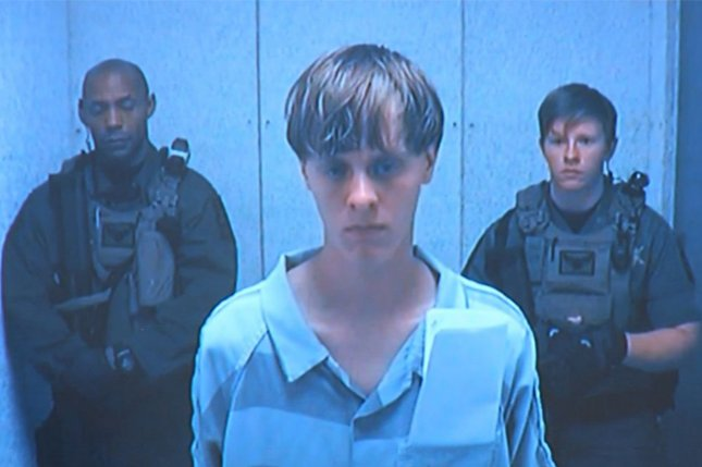 Dylann Roof, accused of killing nine worshipers at a historic Charleston, S.C., church,appears before a judge on June 19, 2015. Roof wrote two handwritten manifestos related to race, federal authorities revealed in a court document on Monday. File Photo Pool/UPI