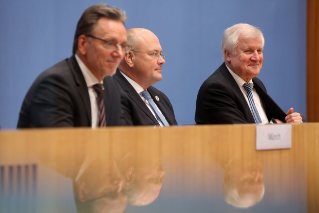 Holger Münch, president of Germany's federal criminal police office, Arne Schoenbohm, president of the federal office for security in information technology, and German Minister of Interior, Construction and Homeland Horst Seehofer attend a press conference about the arrest of a man suspected of spying and unauthorized publication of personal data of politicians, journalists and public figures, in Berlin, Germany, on Tuesday. Photo by Adam Berry/EPA-EFE