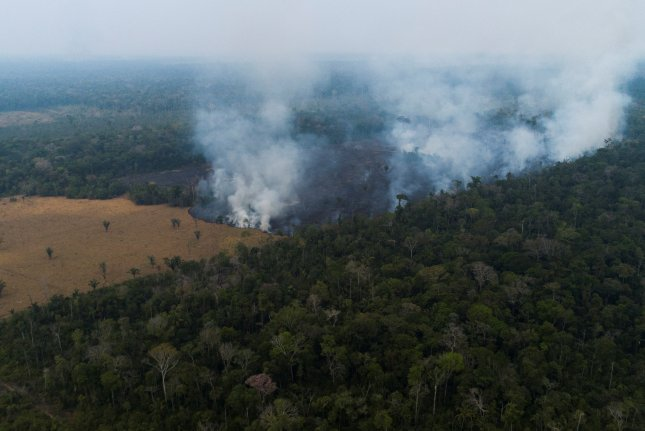 Fires burned in the rain forest near Rondonia, Brazil, on August 24, 2019. A scientific study released on Thursday says that the train forest fires are accelerating the decline of Bolivia's Zongo Glacier. File Photo by Joedson Alves/EPA-EFE