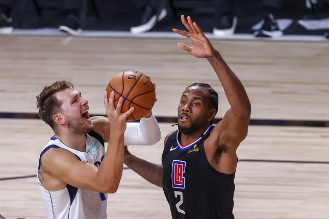 Dallas Mavericks star Luka Doncic (L) attempts a shot over Los Angeles Clippers forward Kawhi Leonard (R) during the second half of Game 6 in their first-round series Sunday at the ESPN Wide World of Sports Complex near Orlando, Fla. Photo by John G. Mabanglo/EPA-EFE