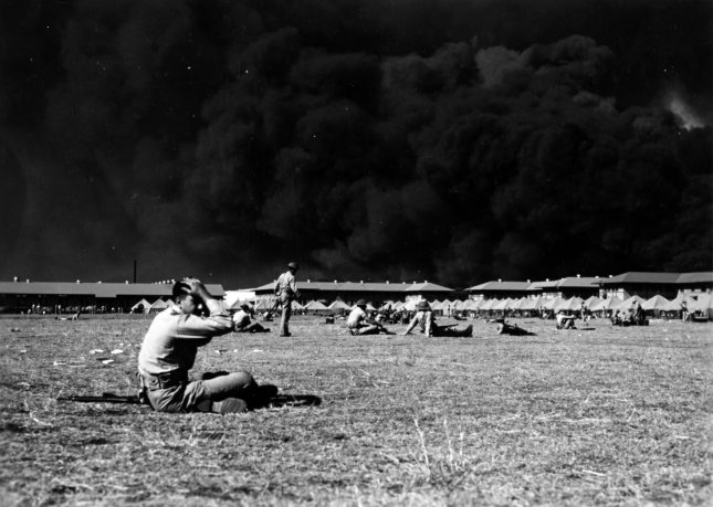 View of the Parade Ground at the Pearl Harbor Marine Barracks, between 0930 and 1130 hrs. on Dec. 7, 1941, with smoke in the background rising from burning ships. File Photo by U.S. Navy/UPI