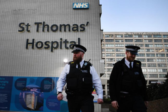 Police stand outside St.Thomas' Hospital in London, Britain, on Tuesday. Johnson spent three nights in intensive care there. Photo by Andy Rain/EPA-EFE