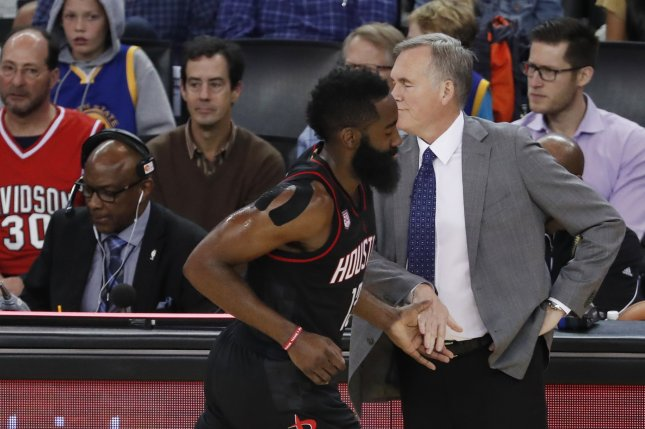 c66132e86bc Houston Rockets guard James Harden (L) low-fives Houston Rockets head coach  Mike D Antoni (R) after scoring against the Golden State Warriors during  the ...