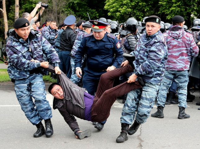 Police detain opposition supporters during a protest calling for free and fair elections during the presidential elections in Nur-Sultan, Kazakhstan, Sunday. Photo by Igor Kovalenko/EPA-EFE