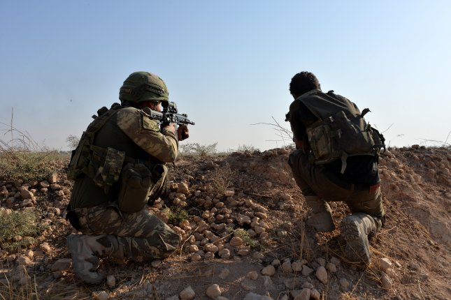 Turkish soldiers patrol a border town in northern Syria on October 18, 2019. An ongoing feud between Turkey and Syria has led to new and deadly attacks in Idlib province, officials said Monday. File Photo by Turkish Defense Ministry/EPA-EFE