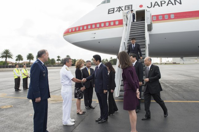 Japanese Prime Minister Shinzo Abe (C) is greeted by U.S. Pacific Command Commander Adm. Harry Harris (2-L) at the start of Abe's Hawaii visit to recognize the Japanese attacks on Pearl Harbor, Joint Base Pearl Harbor-Hickam, Oahu, Hawaii, on December 26, 2016. Abe is the first Japanese leader to publicly view the site of the Pearl Harbor Attack since 1951. Photo by Petty Officer 1st Class Jay Chu/Department of Defense/European Pressphoto Agency