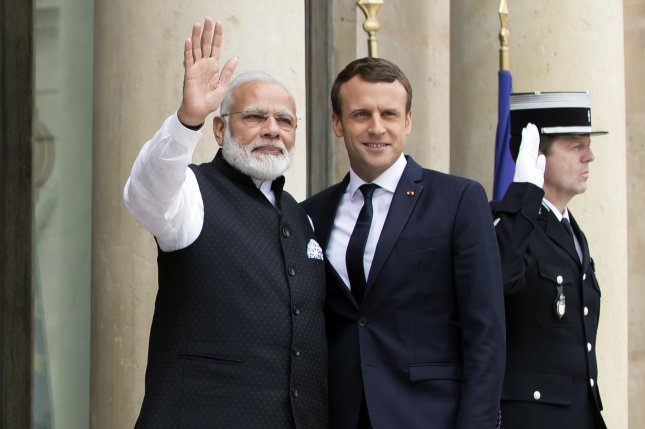 While on a visit to Paris India's Prime Minister Narendra Modi (L) said commitment to the Paris climate change agreement will be a gift that this generation can give. Photo by Ian Langsdon/EPA