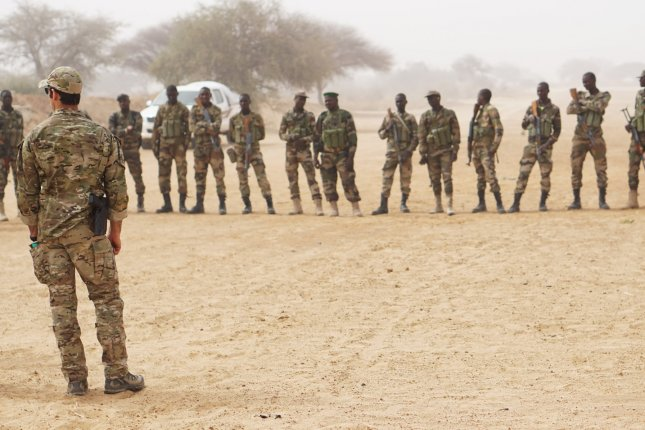 A U.S. Army Special Forces weapons sergeant speaks to a group of Nigerian soldiers during Exercise Flintrock 2017 in March in Diffa, Niger. On Friday, an Islamic State affiliate claimed responsibility for an attacked three months ago in Niger that killed four American soldiers. Photo by Spec. Zayid Ballesteros/U.S. Army