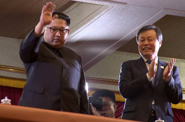 North Korean leader Kim Jong-un (L) and South Korea's Culture Minister Do Jong-hwan attend performance of South Korea's art troupe at the East Pyongyang Grand Theatre in Pyongyang, North Korea. Photo courtesy of S.Korean Art Performance Press Corps.