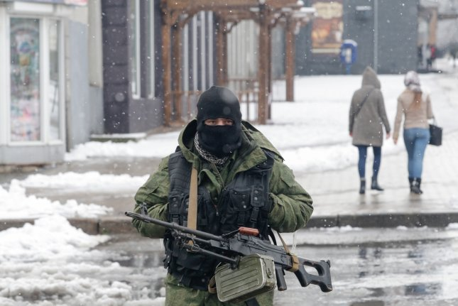 An armed man stands guard in Luhansk, Ukraine, on November 22 as rebels control the city. The Trump administration has approved the sale of lethal defensive weapons to Kiev. Photo by Alexander Ermochenko/EPA-EFE