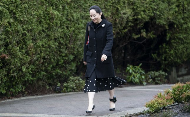 Meng Wanzhou, chief financial officer of Huawei, leaves her home to go to the B.C. Supreme Court in Vancouver, British Columbia, Canada, on Monday. The United States is seeking extradition of Meng since she was detained in December 2018 on charges related to accusations that Huawei had tried to steal U.S. technology and had lied about its relationship with an Iranian subsidiary. Photo by EPA-EFE
