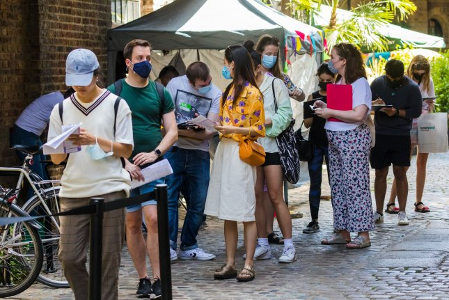 People stand in line at a pop-up COVID-19 vaccination site in Camden Market, in London, England, on Saturday. The British government plans to lift lockdown restrictions July 19. Photo by Vickie Flores/EPA-EFE