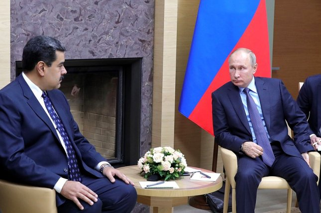 Venezuelan President Nicolas Maduro (L) on Wednesday met Russian President Vladimir Putin during a two-day visit to Russia. Maduro said on Thursday that Russia had committed to help with $5 billion investments to help the country increase its oil production, and $1 billion to help mining, mainly gold. Photo courtesy of the Russian government