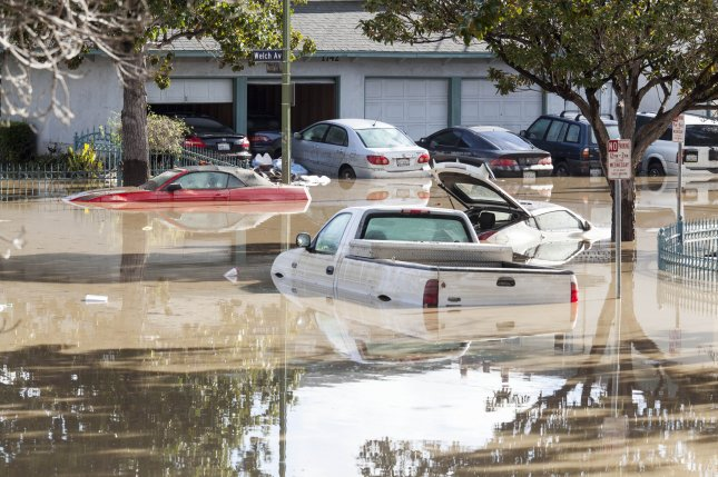 Vehicles sit stranded along Welch Avenue in the Coyote Creek area of San Jose, Calif., after heavy rains in recent days triggered severe flooding. Authorities said it is the worse flooding in the area in more than 100 years. Photo by Peter DaSilva/EPA